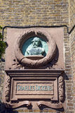 Charles Dickens. A statue of Charles Dickens on the building he stayed at Royalty Free Stock Photography