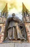 Charles-Emile Freppel statue in front of Saints-Pierre-et-Paul-Church in Obernai, France Royalty Free Stock Photo
