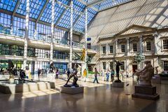 The Charles Engelhard court view with lots of visitors in Metropolitan museum of art. NEW YORK, USA - OCTOBER, 2015: The Charles Engelhard court view with lots stock image