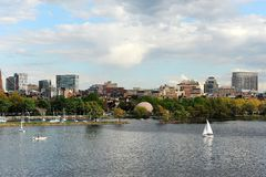 Charles River, Boston in Spring. A view of Boston skyline and the Charles river with white sailboats in the spring stock image