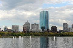 Charles River, Boston in Spring. A view of Boston skyline and the Charles river with white sailboats in the spring royalty free stock images