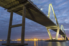 Charleston Bridge. The Arthur Ravenel Jr. Bridge is a cable-stayed bridge over the Cooper River in South Carolina, connecting downtown Charleston to Mount Stock Images