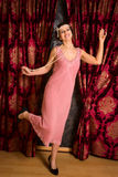 Charleston dancing in flapper dress. Gorgeous vintage 1920s lady dancing the charleston in a flapper dress with headband stock image