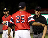 Charleston RiverDogs manager Luis Dorante argues with Umpire. Stock Images