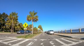 CHARLESTON, SC - APRIL 7, 2018: City oceanfront with tourists on. A sunny day. The city attracts 10 million tourists annually Royalty Free Stock Photos