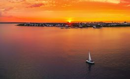 Charleston, SC skyline with a sailboat. Charleston skyline with a sailboat  during sunset with a drone Royalty Free Stock Photo