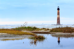 Charleston South Carolina Morris Island Lighthouse. Once a beacon to ships, the defunct Morris Island Lighthouse is an historical site north of Folly Beach near stock images