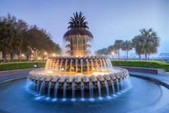 Charleston South Carolina SC Pineapple Fountain. The Pineapple Fountain is illuminated at the waterfront park in Charleston, South Carolina in the early morning stock photography