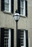 Charleston Street Scene. Image of a street lamp against a background of an urban row house with four windows Royalty Free Stock Photo