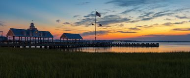 Charleston Sunset. With dock in the ocean Stock Image