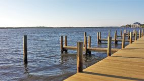 Charleston Waterfront Park. A wooden dock near the northern end of Waterfront Park, an eight acre park along the Cooper River in Charleston, South Carolina Royalty Free Stock Photo