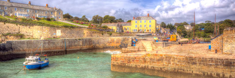 Charlestown harbour panorama near St Austell Cornwall England UK in creative colourful HDR. Panoramic view of Charlestown harbour near St Austell Cornwall Royalty Free Stock Photos