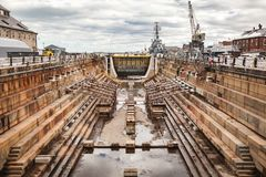 Charlestown Navy Yard Dry Dock 1. Historic dry dock 1 at Charlestown Navy Yard near Boston, Massachusetts sits empty during the winter cold royalty free stock image