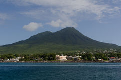 Charlestown, Nevis. A coastal view of Charlestown, Nevis with Nevis Peak in the background Stock Image