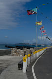 Charlestown, Nevis. Flags of the world displayed at the waterfront in Charlestown, Nevis Royalty Free Stock Images