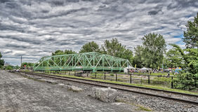 Charlevoix bridge - Lachine Canal. Constructed from ambience recorded on the Charlevoix bridge over the canal east of the Atwater market. Car tires against the Royalty Free Stock Image