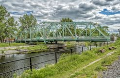 Charlevoix bridge - Lachine Canal. Constructed from ambience recorded on the Charlevoix bridge over the canal east of the Atwater market. Car tires against the Royalty Free Stock Photo
