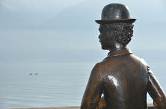 Charlie Chaplin. Bronze statue of Charlie Chaplin at Vevey by lake Geneva, Switzerland where he lived and died Royalty Free Stock Photos