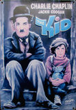 Charlie chaplin - the kid. Very old metal advert of film The Kid with charli chaplin and jackie coogan Royalty Free Stock Photography