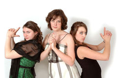 Charlies Angels. Three teenage girls stirke a charlies Angels pose for fun in their formal attire Royalty Free Stock Photography