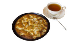 Charlotte. Apple pie with a cup of black tea on a white backgrou Stock Photos