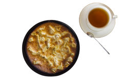 Charlotte. Apple pie with a cup of black tea on a white backgrou Stock Images
