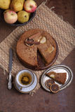 Charlotte with apples and cinnamon and a cup of tea Royalty Free Stock Image
