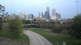Charlotte city skyline and morning commute stock video