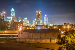 Charlotte City Skyline night scene. Charlotte City Skyline and architecture at night and milling factory royalty free stock image