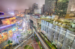 Charlotte city skyline night scene in  fog Stock Photo