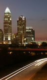 Charlotte, NC Skyline. Charlotte North Carolina skyline at dusk with car travelling into town Royalty Free Stock Photography