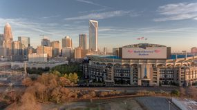 Charlotte, NC skyline near sunset with Bank of America stadium in front stock images