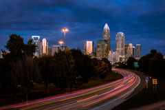 Charlotte Rush Hour 2. The sky starting to light up during the morning rush hour commute in Charlotte, North Carolina. The cars brake lights appear as streaks of Royalty Free Stock Photography