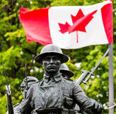 War Memorial. War memorial and Canadian flag Royalty Free Stock Photos