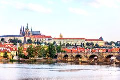 Charlse Bridge and Vltava river view with Prague Castle on the b stock photography