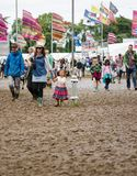 Festival goers at muddy Womad Stock Image