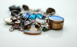 Charm Bracelet. A charm bracelet overloaded with charms Stock Images