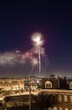 Charm city fireworks. Fireworks soar high over Baltimore's Inner Harbor; lighting up the night sky Royalty Free Stock Photo