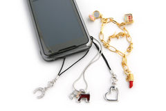 Charm Hanging from Cell Phone Royalty Free Stock Images