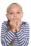 Charmant meisje met een gevoelvolle starende blik Stock Afbeelding