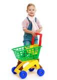 Charmant meisje met een stuk speelgoed vrachtwagen Stock Fotografie