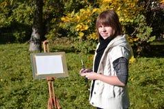 Charmante kunstenaar in een park Stock Fotografie
