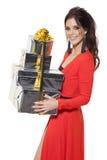 Charmante Vrouw die Vele Giften houden Gelukkig Nieuwjaar Royalty-vrije Stock Foto's