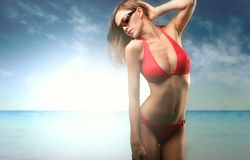 Charme. A beautiful woman in bathing Royalty Free Stock Image