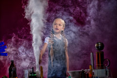 Charmed little girl pocing in cloud of steam Royalty Free Stock Photos