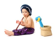 Charmer boy with pipe Stock Photography