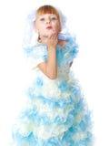 Charmig flicka i vit- och blåttklänning Royaltyfria Bilder