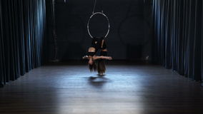 Charming acrobats performs a trick in the aerial hoop stock video
