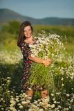 Charming adorable young lady woman dark brunette hairs and green eyes tender posing with flowers wreath on head top and huge royalty free stock image
