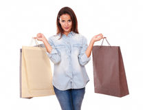 Charming adult brunette holding shopping bags Stock Image